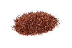 Heap of red rooibos traditional organic tea on Royalty Free Stock Images