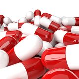 Heap of red-white capsules Royalty Free Stock Photo