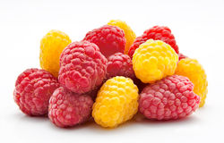 Heap of red and yellow raspberry on white Stock Photography