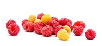 Heap of red and yellow raspberry  Stock Photos