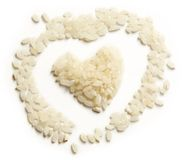Heap of rice and heart form Stock Image