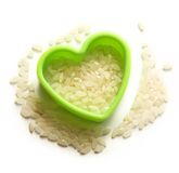 Heap of rice and heart form Royalty Free Stock Photo