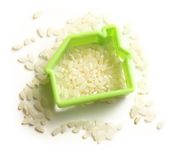 Heap of rice and home image Royalty Free Stock Photography