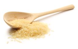 Heap of rice with wooden spoon Royalty Free Stock Images