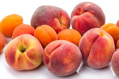 Heap ripe apricots and peaches Stock Image