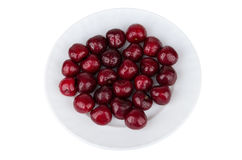Heap of ripe cherries with droplets in white glass plate Stock Photo