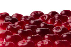 Heap of ripe cherries without tails on a white background. Royalty Free Stock Photography