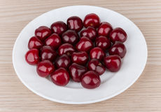 Heap of ripe cherries in white glass plate Royalty Free Stock Images