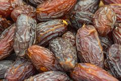 Heap of Ripe Dried Large Brown Dates at Farmers Market. Vibrant Color. Organic Produce Healthy Plant Based Diet. Concept Stock Photos