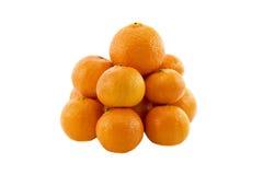 Heap of ripe fresh juicy tangerines mandarins. Isolated over white background Royalty Free Stock Photos
