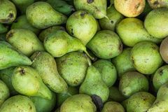 Heap of Ripe Organic Green Pears in Wooden Box at Farmers Market. Bright Vibrant Colors. Vitamins Superfoods Healthy Diet Stock Photography