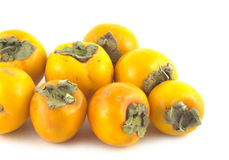 Heap of ripe persimmons isolated on white Royalty Free Stock Image
