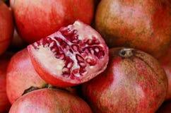 Heap of ripe pomegranates at the market Royalty Free Stock Photo