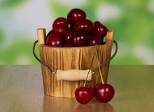 Heap ripe sweet cherries which dropped out of Royalty Free Stock Photos
