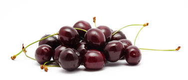 Heap of ripe sweet cherry isolated on a white Royalty Free Stock Photos