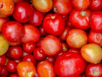 Heap of ripe tomatoes in a market stock photos
