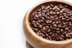 Heap of Roasted Aromatic Coffee Beans Placed in Wooden Bowl over Royalty Free Stock Images