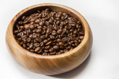 Heap of Roasted Aromatic Coffee Beans Placed in Wooden Bowl over Royalty Free Stock Photo
