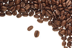 Heap roasted coffee beans as decorative frame with copy space isolated on white background. Royalty Free Stock Photos