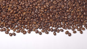 Heap of roasted coffee beans on white Stock Photo