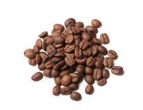 Heap of roasted coffee beans on white Stock Photography