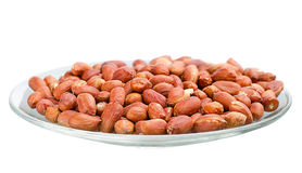 Heap of roasted peanuts in a saucer Stock Images