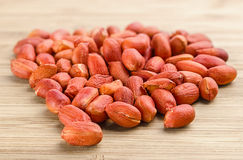 Heap of roasted peanuts on the wooden background Stock Image
