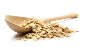 Heap of rolled oats with wooden spoon Royalty Free Stock Photography