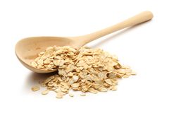 Heap of rolled oats with wooden spoon Royalty Free Stock Photos