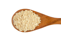 Heap of rolled oats with wooden spoon Stock Photography