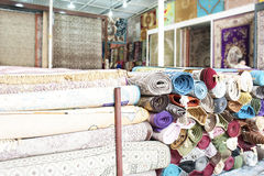Heap of rolled up rugs in rug store Stock Photo