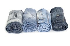 Heap rolls of jeans Stock Image