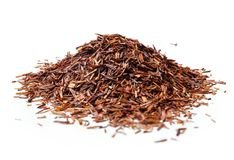 Heap of Rooibos tea on white background. Close up. High resolution Royalty Free Stock Image