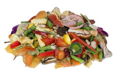 Heap of rotten food. On a white table lies a heap of rotten food waste closeup concept Stock Photos