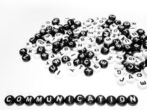 Heap of round letters black and white and communication word written by side Stock Photography