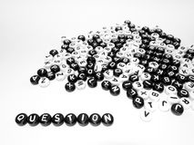 Heap of round letters black and white and word written by side Royalty Free Stock Images