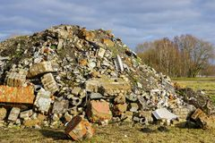 Heap of rubble after demolition of an old house royalty free stock photo
