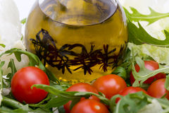Heap of ruccola, lettuce,  tomatoes and olive oil Royalty Free Stock Photography