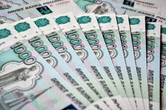 Heap of russian rouble banknotes Stock Photo