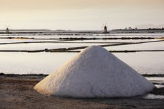 Heap of Salt infront of sicilian salt mills in Trapani Stock Photos