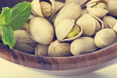 Heap salted pistachio nuts on wooden spoon background Royalty Free Stock Photos