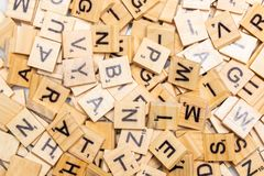 Heap of scrabble tile letters from above. Full frame royalty free stock photo