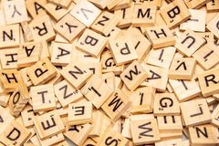 Heap of scrabble tile letters from above. Full frame stock photography