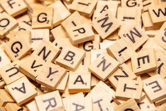 Heap of scrabble tile letters from above. Full frame royalty free stock photos