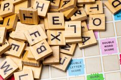 Heap of scrabble tile letters from above stock photography