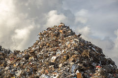 Heap of scrap iron. Against dramatic sky stock image