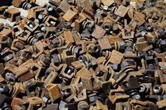 Heap of screw-bolts and nuts. And other roofing timbers of very largeness Stock Photo