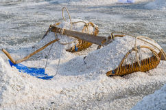 Heap of sea salt on the hod. Selective Focus. Stock Photos
