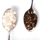 Heap of sea salt and peppercorn Royalty Free Stock Images