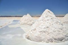 Heap of sea salt in Salar Uyuni. Heap of sea salt in a Bolivian salt flat prepared for harvest Stock Photo